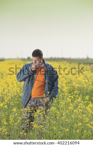Farmer in rapesees field