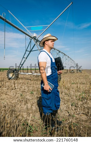 Farmer on irrigation systems - stock photo