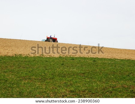 Farmer plowing a field with tractor