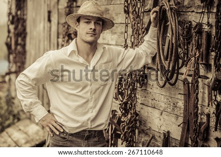 Farmer Portrait in front of a Wall Full with Old Rusty Tools