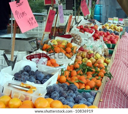 farmer's market fruit display showing many fruits - stock photo