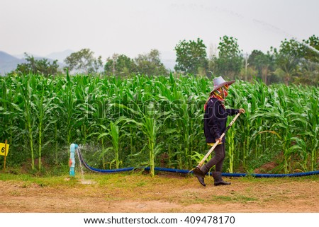 Farmer With Corn Field Background - stock photo