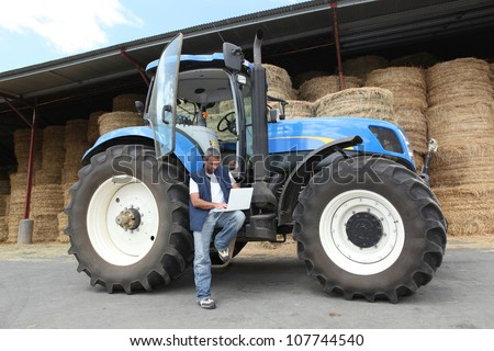 Farmer with his tractor - stock photo