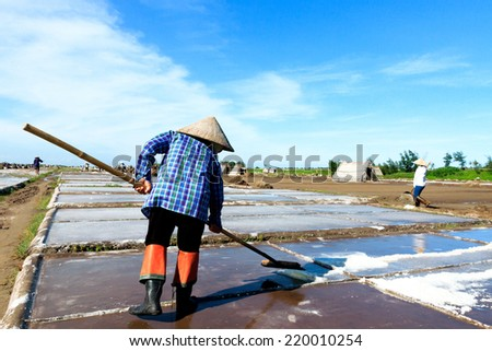 Farmers carrying the salt on the baskets in NamDinh, Vietnam