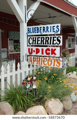 Farmers fruit signs at U-pick farm in Michigan in Summer