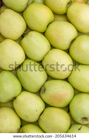 Farmers market apples background. At the farmers market local growers come and sell their freshly picked crops at reasonable prices. - stock photo