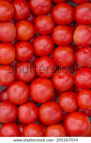 Farmers market tomato  in a wooden crates,  background. At the farmers market local growers come and sell their freshly picked crops at reasonable prices. Selective focus.  - stock photo