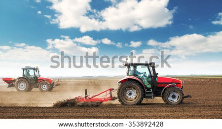 Farmers preparing land and fertilizing - stock photo