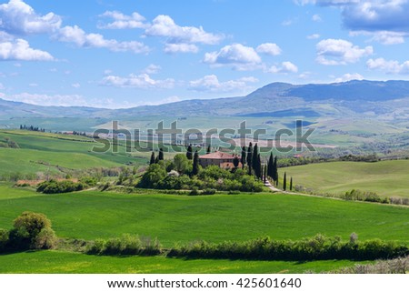 Farmhouse, green hills,cypress trees in Tuscany at sunset in Italy,Europe - stock photo
