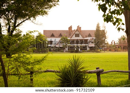 farmhouse in country side - stock photo