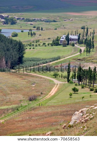 farmhouse in the freestate, south africa, with dirt road leading up to house - stock photo