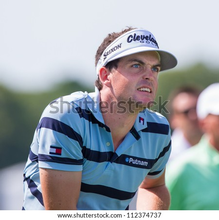 FARMINGDALE, NY - AUGUST 21: Keegan Bradley watches his drive at Bethpage Black during the Barclays on August 21, 2012 in Farmingdale, NY.