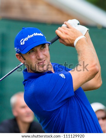 FARMINGDALE, NY - AUGUST 22: Long Hitting Dustin Johnson hits a drive at Bethpage Black during the Barclays on August 22, 2012 in Farmingdale, NY. - stock photo
