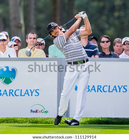 FARMINGDALE, NY - AUGUST 21: Rickie Fowler hits a drive at Bethpage Black during the Barclays on August 21, 2012 in Farmingdale, NY. - stock photo