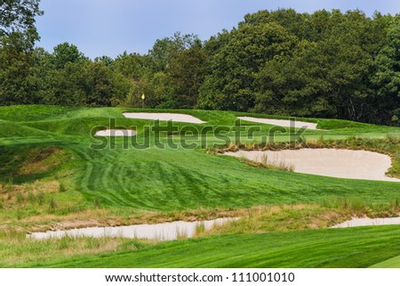 FARMINGDALE, NY - AUGUST 21: The 4th on Bethpage State Park's black course on August 21, 2012 in Farmingdale, NY. Designed by AW Tillinghast, this is open to the public for a low fee. - stock photo