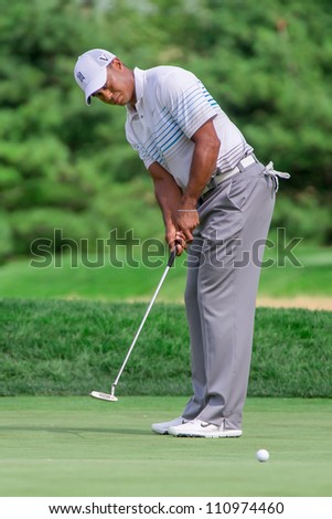 FARMINGDALE, NY - AUGUST 22: Tiger Woods hits a putt at Bethpage Black during the Barclays on August 22, 2012 in Farmingdale, NY. - stock photo