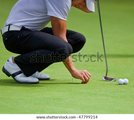 FARMINGDALE, NY - JUNE 16: Columbian Camilo Villegas practices his putting during the 2009 US Open on June 16, 2009 in Farmingdale, NY. - stock photo