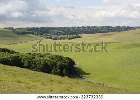 Farmland and countryside by Beachy Head near Eastbourne. East Sussex. England. Village of Eastdean in distance. - stock photo
