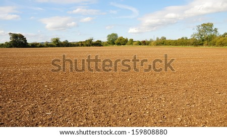 Farmland View of a Ploughed Field in Autumn - stock photo
