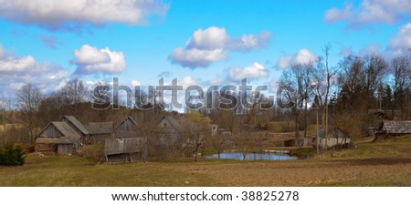 Farmyard with pond in eastern Latvia