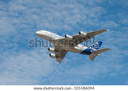 FARNBOROUGH, UK - JULY 25: Airbus A380 passenger jet fly-pass at the International Airshow held every two years at the former Royal Aircraft Eastambishment (RAE) in the Farnborough, UK - July 25, 2010 - stock photo