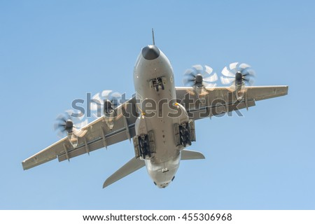 FARNBOROUGH, UK - JULY 14: Close-up of an Airbus A400M military transporter aircraft in a steep climb after take-off from Farnborough, Hampshire, UK on July 14, 2016 - stock photo