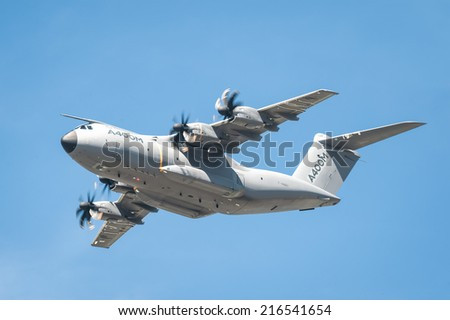 FARNBOROUGH, UK, JULY 18: Closeup of an Airbus A400M military and emergency aid transporter aircraft in low-level flight over Farnborough, Hampshire, UK on July 18, 2014