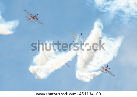 FARNBOROUGH, UK - JULY 5: Global Stars formation aerobatic display team in the skies over Farnborough, Hampshire, UK on July 5, 2016 - stock photo