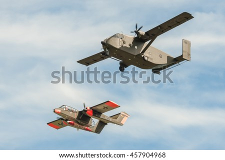 FARNBOROUGH, UK - JULY 18: Short SC7 Skyvan and a vintage Rockwell OV-10 Bronco light attack aircraft on take-off from Farnborough, UK on July 18, 2016 - stock photo