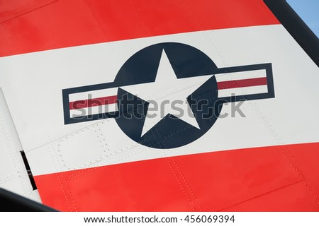 FARNBOROUGH, UK - JULY 15: Tail fin insignia close-up of a maritime patrol aircraft operated by the US Coast Guard on display at Farnborough, UK on July 15, 2016 - stock photo