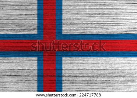 Faroe Islands flag painted on wood background  - stock photo