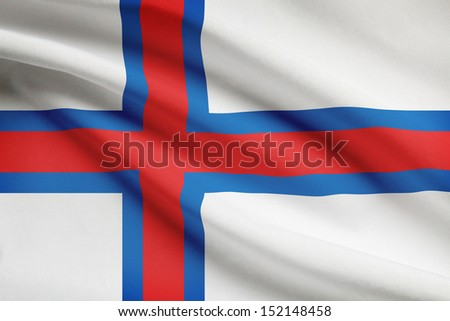 Faroese flag blowing in the wind. Part of a series.