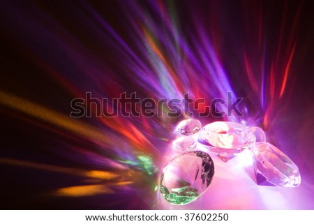 Fascinating rainbow colors due to light dispersion in crystals - stock photo