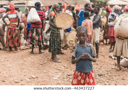 FASHA, ETHIOPIA - August 15,2015: unidentified people from Konso tribe take part at the weekly market in Fasha. Konso women dress typical skirt with multicolored stripes