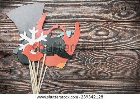 fashion accessories for a fun holiday of paper, lips, mustaches, hats. - stock photo
