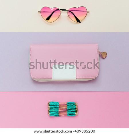 Fashion Accessory Season. Eyeglasses, Bracelets, Clutch. Be Pastel trend. - stock photo