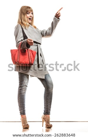 Fashion and advertisement concep t.Full body woman elegant gray belt coat holding red handbag pointing copy space empty blank isolated - stock photo
