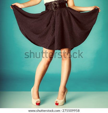 Fashion and beauty of female part body. Sexy girl legs in high heels. Studio shot. Retro and vintage photo. - stock photo