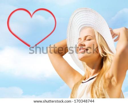 fashion and lifestyle concept - beautiful woman in hat enjoying summer outdoors - stock photo
