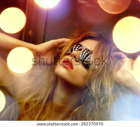 fashion and people concept - beautiful woman in sunglasses in elevator - stock photo