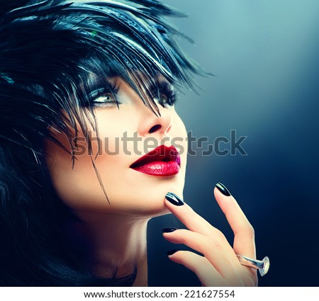 Fashion Art Portrait Of Beautiful Girl. Vogue Style Woman. Hairstyle. Black Hair and Nails, red lipstick. Isolated on Black Background. Beauty Stylish Model Portrait  - stock photo