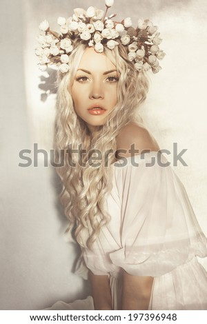 Fashion-art portrait of romantic blonde with wreath of flowers - stock photo