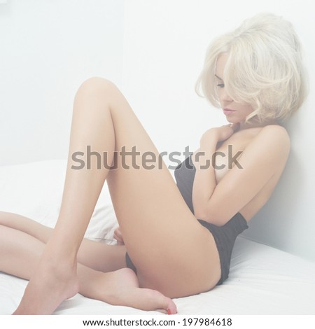 Fashion art portrait of young elegant woman in bed - stock photo