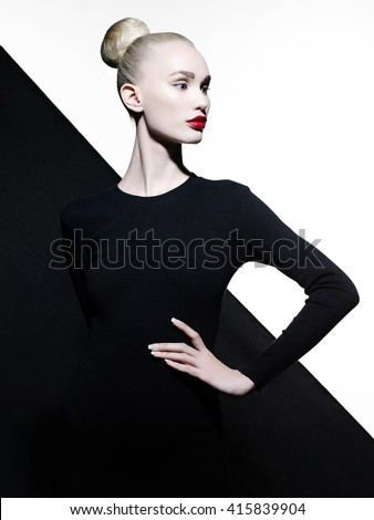 Fashion art studio portrait of elegant blode in geometric black and white background - stock photo