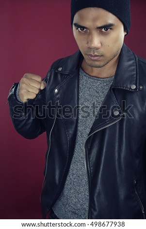 Fashion asian boy wearing a black leather jacket