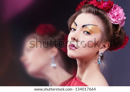 Fashion asian woman wearing traditional japanese red kimono, studio shot. Geisha - stock photo