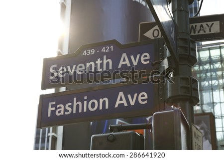 Fashion avenue sign against the sun. Seventh avenue.