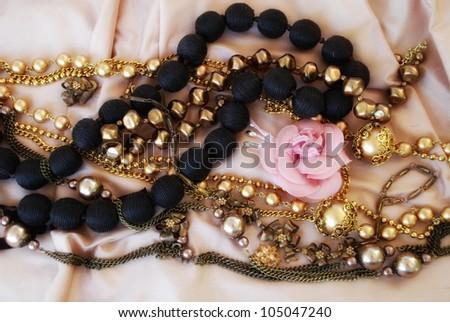 fashion beads on silk background - stock photo