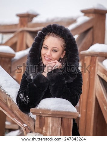 Fashion beautiful blonde woman  in the black coat. - stock photo