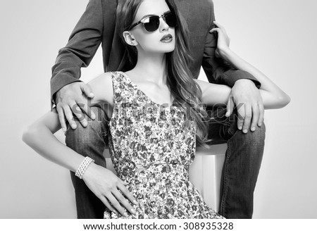 fashion beautiful couple in sunglasses. woman near the man.beauty girl and boy together.monochrome portrait - stock photo